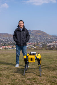 Wang with the new robot