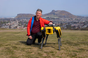 Prof Yvan Petillot with the new robot sitting